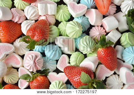 Festive sweets on brown background close up