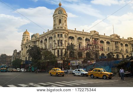 KOLKATA, INDIA -FEBRUARY 12, 2017: Morning city traffic in front of Metropolitan heritage architectural building at Esplanade Kolkata, India.