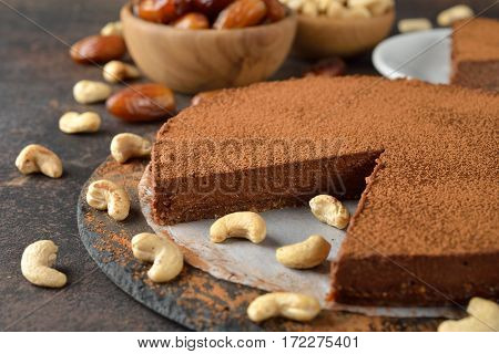 Vegan chocolate cake with cashew nuts and dates