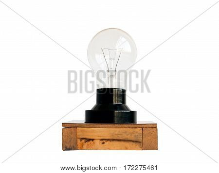 Incandescent bulbs on a wooden base isolated on white background with clipping path.
