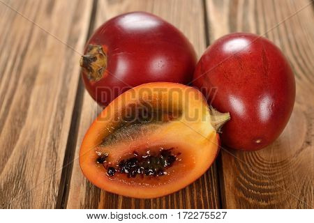 Exotic fruit tamarillo on a brown background