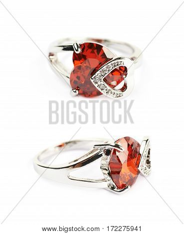 Silver ring with a red heart shaped gem isolated over the white background, set of two different foreshortenings