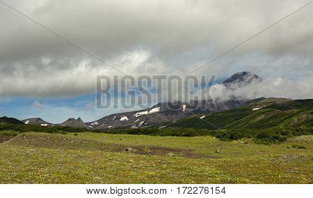 Avacha Volcano or Avachinskaya Sopka in the clouds on the Kamchatka Peninsula