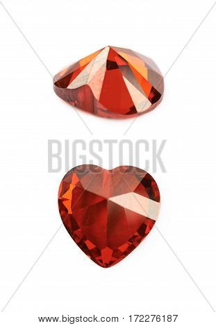 Heart shaped red gem stone isolated over the white background, set of two different foreshortenings