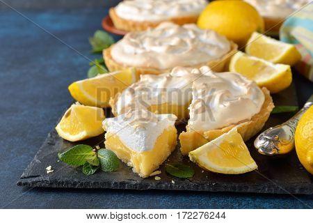 Lemon pie with meringue on a blue background