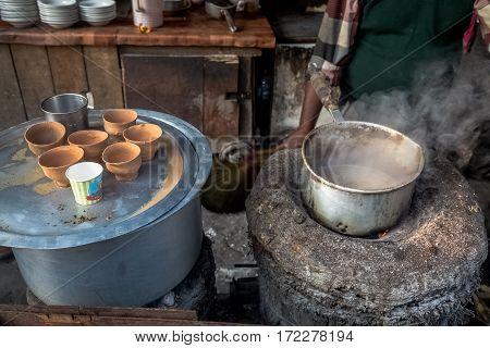Roadside tea stall preparing morning tea for commuters.