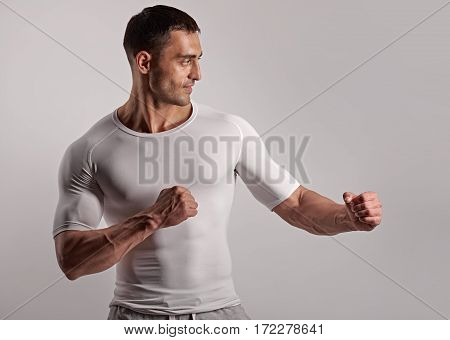 Portrait of young strong boxing man ready to fight