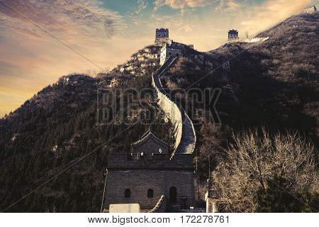 The Great Wall of China under beautiful sunset sky. Shot in Beijing China