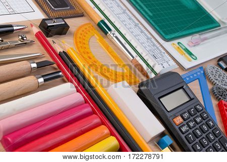 Desk With School Stationary Or Office Tools. Flatlay Set Of Artist School Stationery Studio Shot On