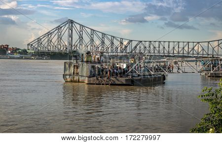 KOLKATA, INDIA -OCTOBER 12, 2016: Ferry service from Babughat on the river Hooghly overlooking the historic Howrah bridge in Kolkata.