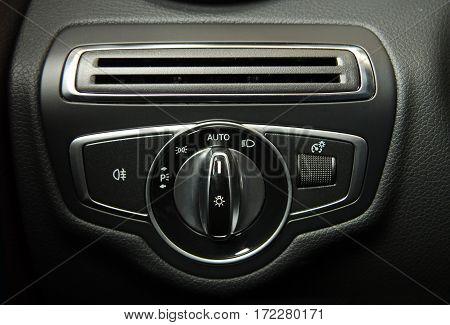 Closeup image of car lighting control switch