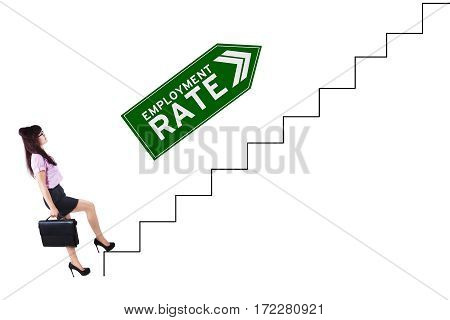 Picture of female job finder walking on the staircase with employment rate text on the upward arrow