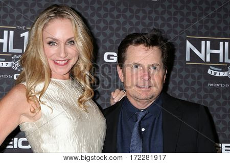 LOS ANGELES - JAN 27:  Tracy Pollan, Michael J. Fox at The NHL100 Gala at Microsoft Theater on January 27, 2017 in Los Angeles, CA