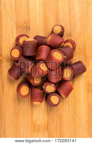 Meaty Filled Dog Treats Isolated On A Wood Background