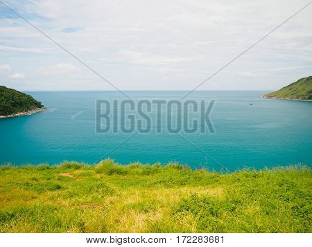 Blue sea green grass and island at Phromthep Cape phuket Thailand