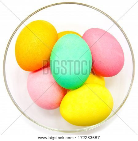 Colorful easter eggs isolated in bowl on white background