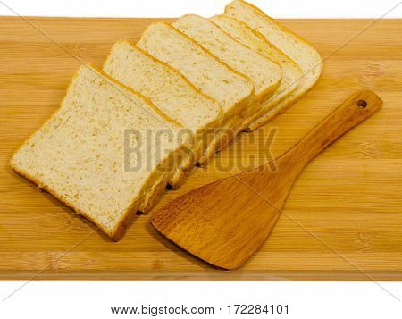 Side view of slices of toast bread on breadboard wooden, isolated on white background