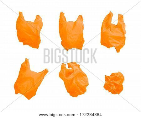 Collection of orange color plastic bag in different composition isolated on white background.