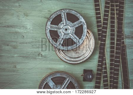 An old roll of film lying on a wooden table