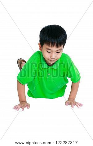 Push-ups or press-ups exercise. Young asian child warming up and doing push-ups. Muscular and strong guy exercising. Isolated on a white background. Sports and active lifestyle. Studio shot.