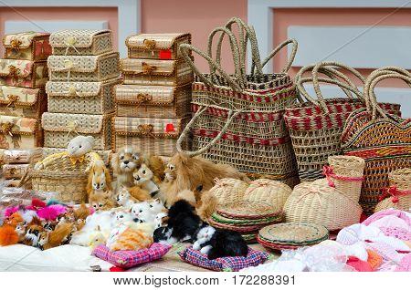Street trade on Slavonic Bazaar in Vitebsk. Wicker caskets baskets stuffed toys