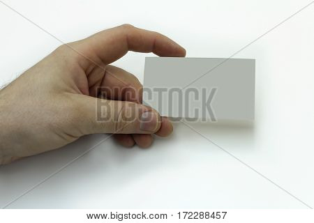 Hand holding a business card. Isolated image