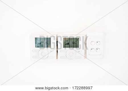 Close Up At Air Conditioner Controller On White Wall