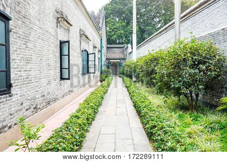Stone Alley in china with green hedge