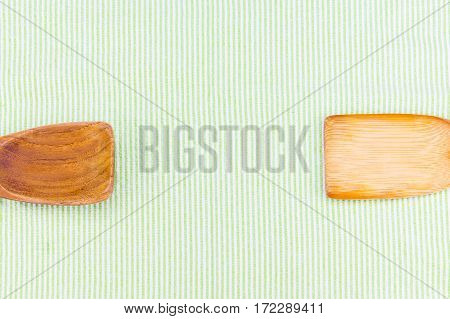 Top View Of Wooden Spoon On Green Pattern Tablecloth, Copy Space For Adding Your Text