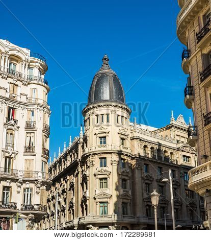 Building at the Gran Via street in the center of Madrid, Spain.