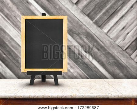 Blackboard Menu With Easel On Marble Table With Blur Diagonal Wood Wall At Restaurant Background, Co