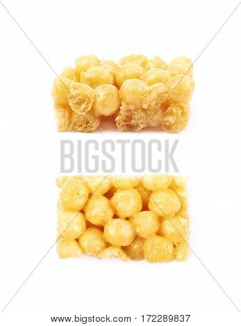 Cornflake balls caramel candy isolated over the white background, set of two different foreshortenings