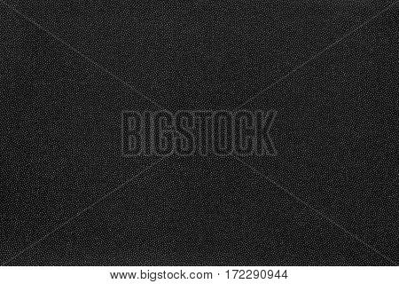 abstract speckled texture and background of textile material or fabric of black color