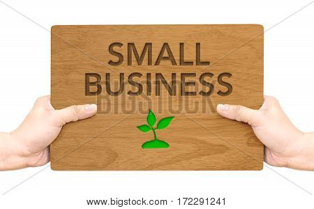 Hand Holding Dark Brown Wood Signboard With Small Business Word Isolated On White Background,busines