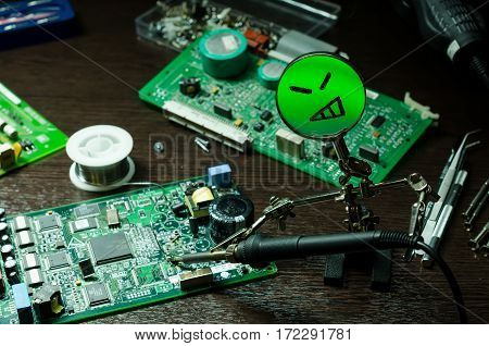 men repair with Magnifying glass electronic board. tools