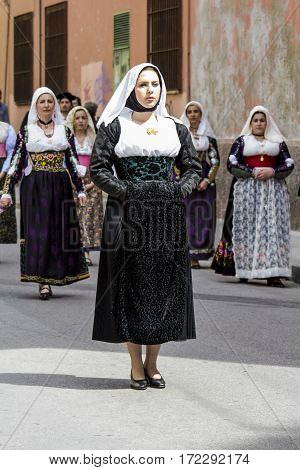 CAGLIARI, ITALY - May 1, 2014: 358 Religious Procession of Sant'Efisio - Sardinia - portrait of a beautiful woman in traditional Sardinian costume
