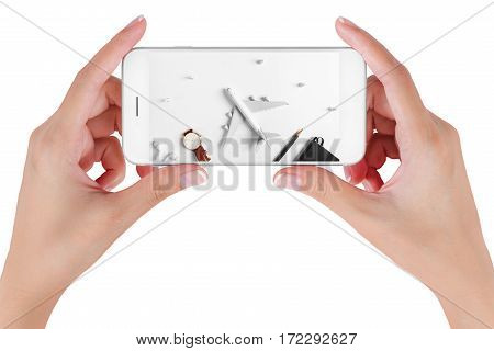 Woman hand using smart phone searching Preparation for Traveling with Airplane model flying among paper clouds. Travel concepts Isolated on white background.