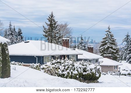 Street of residential houses in suburban of Vancouver. Family houses in snow on winter season