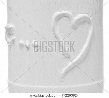 Heart painted in white glass. Dish on a white background.