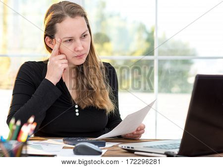 Young And Confident Business Woman Working At Table In Office