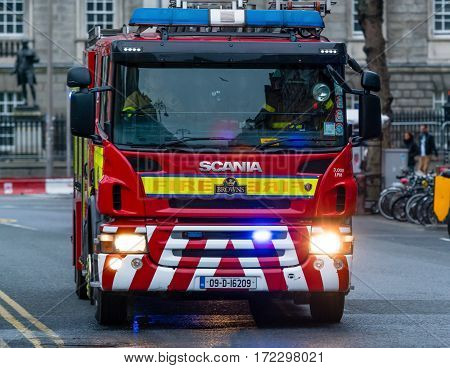 Dublin, Ireland - 19 Feb 2017: Irish firefighters in the fire brigade vehicle