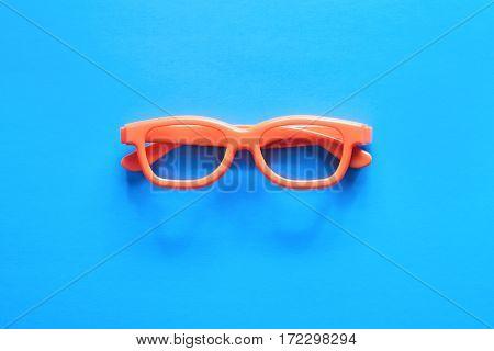 Orange Glasses On A Blue Background