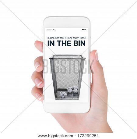Woman using her smart phone searching waste paper bin information Crumpled paper balls inside waste paper bin. in clean and recycle concept Isolated on white background.
