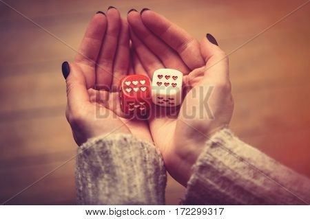 Hands Holding Dice