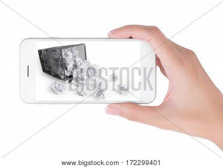 Woman using her smart phone searching waste paper bin information waste paper Basket tumbled on white background. in clean and recycle concept Isolated on white background.