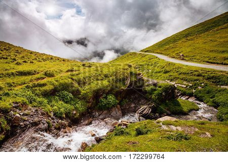 Great view of alpine misty hills and glacier stream. Picturesque and gorgeous scene. Location place Swiss alps, Grindelwald valley, Bernese Oberland, Europe. Discover the world of beauty.