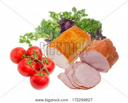 Partly sliced smoked cooked ham with pork loin and piece ham with turkeys cluster of tomatoes against the background of a bunch of the cilantro parsley and basil on a light background