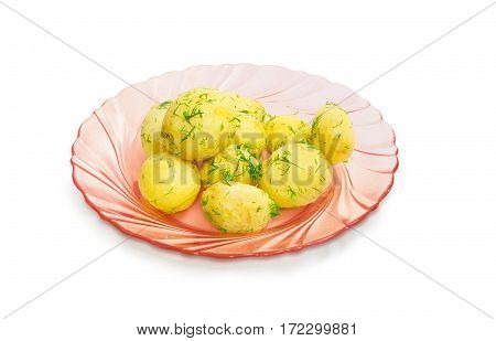 Boiled whole young potatoes of early ripening with a butter sprinkle with the chopped dill on the pink glass dish on a light background