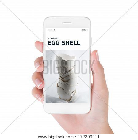 Woman using her smart phone for searching tower of egg shell on vintage background in still life photography Food and drink concept isolated on white background.