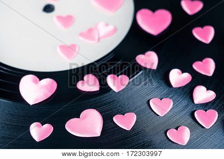 Detail of vintage record with white blank label and many pink decorative hearts